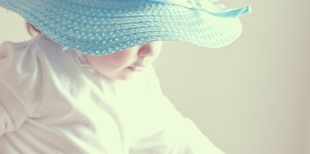 Little Girl in Blue Hat by Mary Banducci