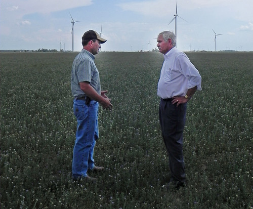 Roy Klopfenstein (left) and Agriculture Under Secretary for Farm and Foreign Agricultural Service (FFAS) Michael Scuse (right) look at Klopfenstein's alfalfa field and how the drought has impacted his crop in Paulding County OH on Tuesday, July 17, 2012. USDA photo by Christina Reed.