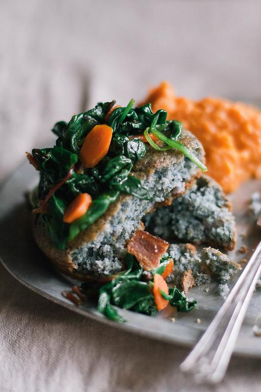 pork confit & black eyed pea cassoulet with apple & sweet potato mash, blue cornbread, and greens