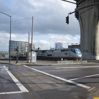 A northbound Coast Starlight passes under the Fremont Bridge
