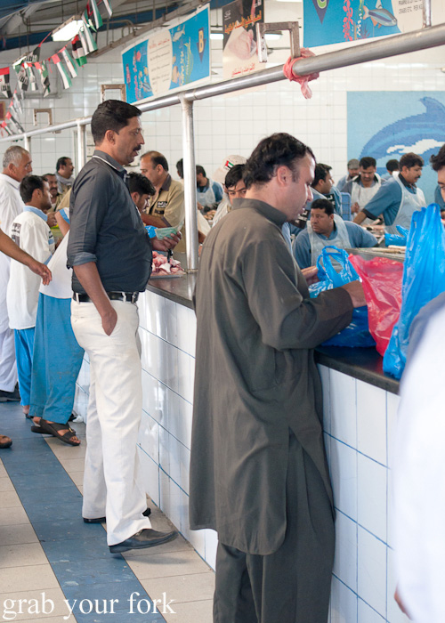 Customers at Dubai Fish Market in Deira