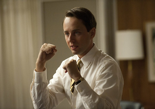 Pete Campbell with his hands up, ready to fight