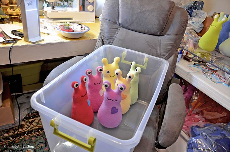 Assorted fleece Hug Me Slugs, original art toys by Elizabeth Ruffing