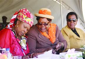 Vice-President Mujuru, Zanu-PF secretary for Women's Affairs Cde Oppah Muchinguri (left) and President of the Senate Cde Edna Madzongwe exchange notes during celebrations marking the conferring of Cde Mujuru with the Distinguished African Amazon Award. by Pan-African News Wire File Photos