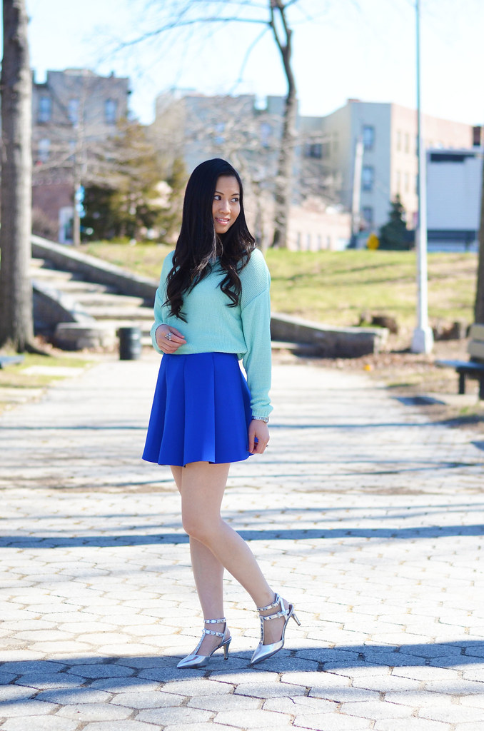 mint sweater, blue structured pleated mini skirt spring outfit