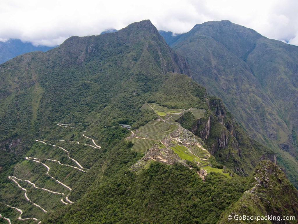A wider view of Machu Picchu from atop Wayna Picchu. The road used by the buses to take visitors up and down (the easy way) can be seen on the left