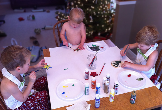 Boys painting ornaments