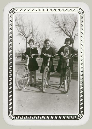 Three girls on bikes