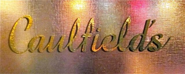 Caulfield's logo