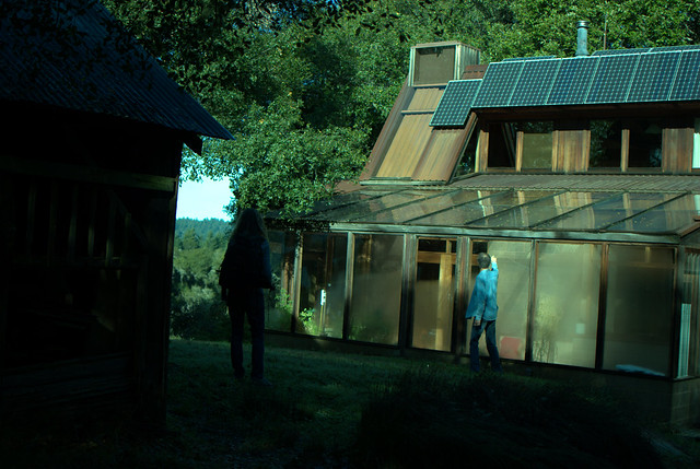 loren amelang's house (sunroom/greenhouse next to him and solar panels on the roof)
