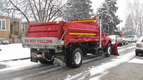 Elmwood Park Department Of Public Works International snowplow equipped dump truck plowing and salting North 74th Court.  Elmwood Park Illinois USA.  Thursday, January 12th, 2012. by Eddie from Chicago