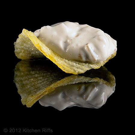 Clam Dip on Ridged Potato Chip on Black Acrylic