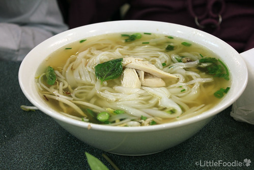 Rice noodle soup with sliced chicken