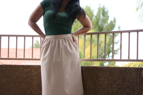 green shirt and striped skirt.