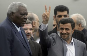 Iran's President Mahmoud Ahmadinejad (R) gestures to the media next to Cuba's Vice president Esteban Lazo at Havana's Jose Marti Airport January 11, 2012. Iran's leader is visiting four Latin American states. by Pan-African News Wire File Photos