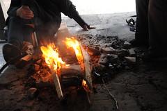Homeless men burning crates to keep warm in the winter, public park, Seattle, Washington, USA