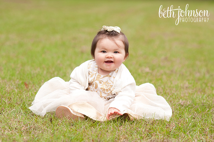baby girl in gold and white holiday dress tallahassee photography