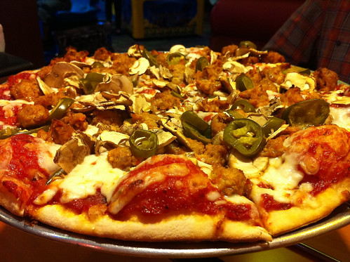 Shakey' pizza: Medium thin crust with italian spicy sausage, mushrooms, and jalapenos