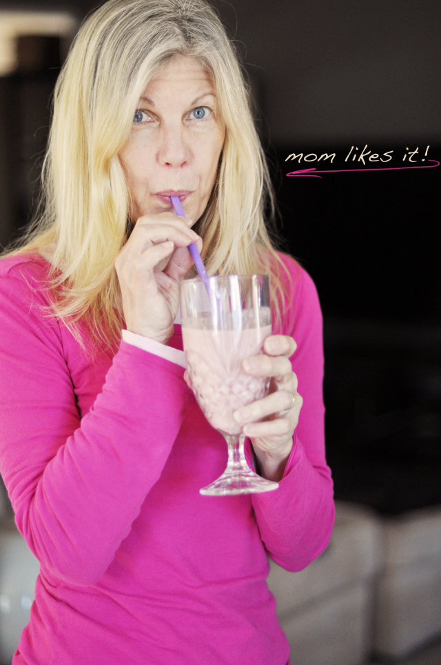 mom drinking a smoothie-