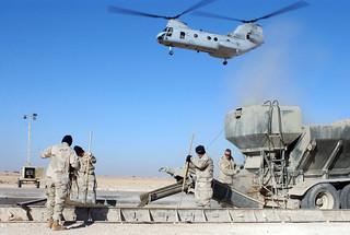 US Marine  CH-46 passes Navy Seabees