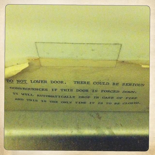 Sign on Dumbwaiter Door