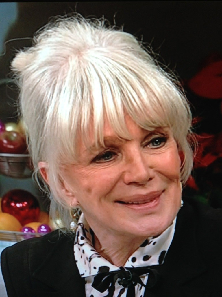 Linda Evans now. Face is stretched & stiff in weird places ...
