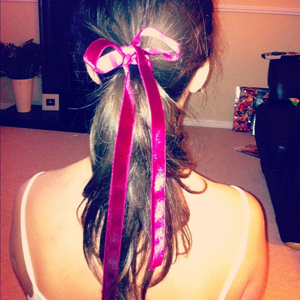 With a smile and a ribbon in my hair..