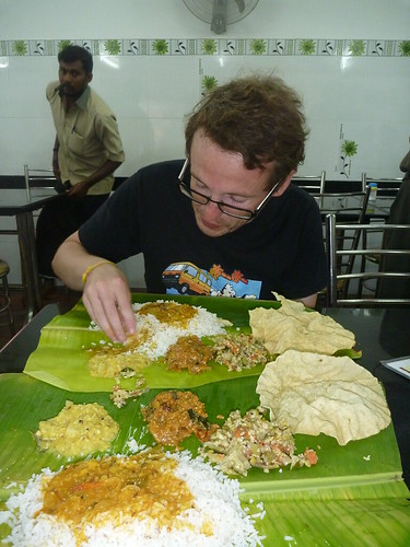 Col digging in to a thali meal