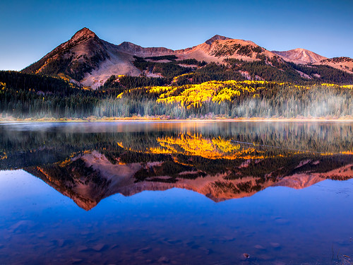morning blue autumn light usa mountains reflection fall nature water america sunrise season landscape rockies scenery colorado seasons unitedstates fallcolors scenic jagged rockymountains wilderness peaks crestedbutte