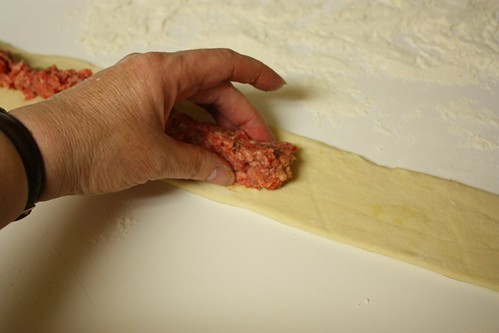 Placing meat on dough