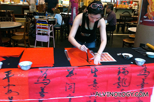Chinese calligraphy is available at the Singapore Food Trail