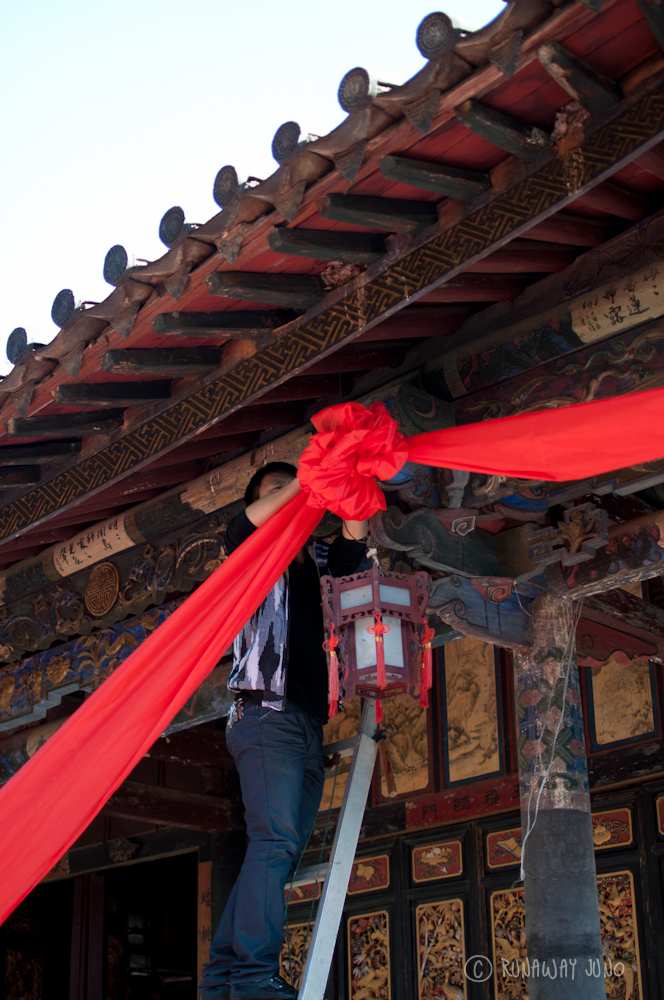 Setting up red bow for Chinese New Year