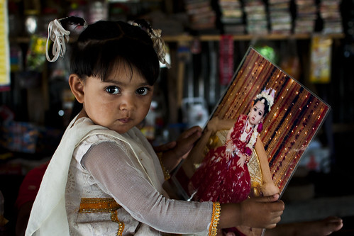 A Little Girl With Her Photograph