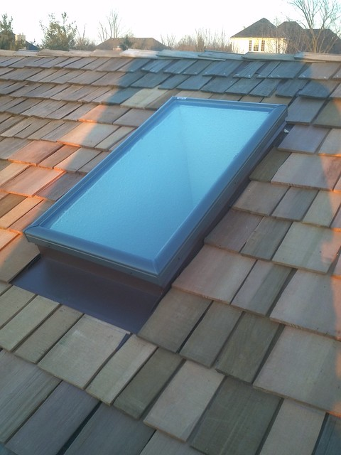 Velux Skylight installation in a cedar roof