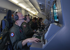 Crew members aboard a P-8A Poseidon man their workstations while assisting in search and rescue operations for Malaysia Airlines flight MH370 over the Indian Ocean, March 16. (U.S. Navy/MC2 Eric A. Pastor)