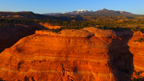 trees sunset usa mountains art nature forest landscape utah unmodified spring unitedstates desert artistic outdoor bluesky canyon erosion vista northamerica redrocks rockymountains southernutah springtime rockformations unedited drone snowcappedmountains moabutah nofilters noadjustments dji straightoffthecamera lasaljunction quadcopter phantom3professional