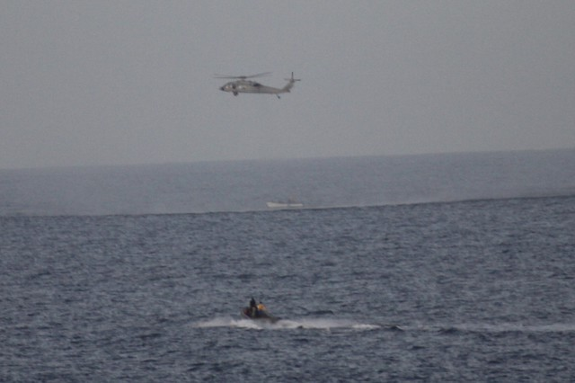 An SH-60 Seahawk of HSC-23 stationed aboard USS Benfold assisted four stranded mariners near San Clemente Island