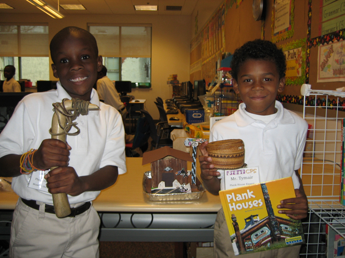 Studenst from the Community Partnership School in Philadelphia get to hold objects from the Native American Loan Box.