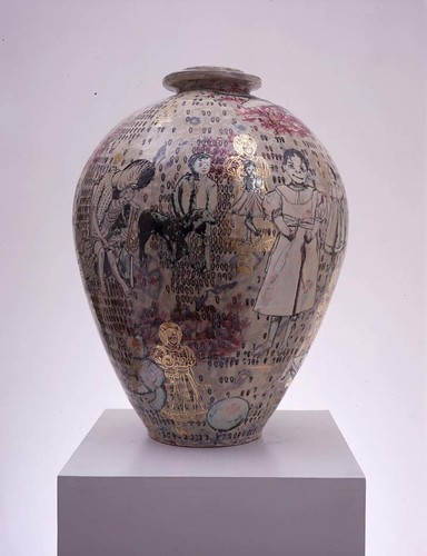 A painted ceramic vase with illustrations in purple and gold