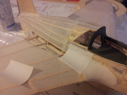Gluing paper fillets to wing and fuselage of me163