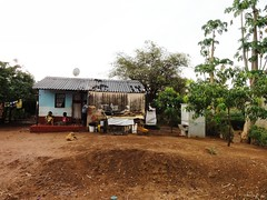 Prefabricted toilet unit next to a house in Libuyu