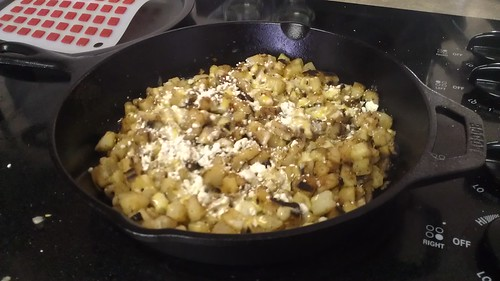 iron skillet fried potatoes with shallots and fetta cheese by billgould