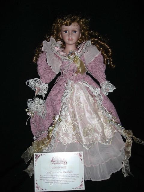 Porcelain dumpster doll