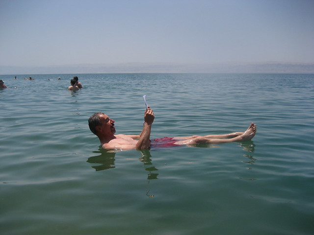 Dead Sea, man reading by Arian Zwegers, on Flickr
