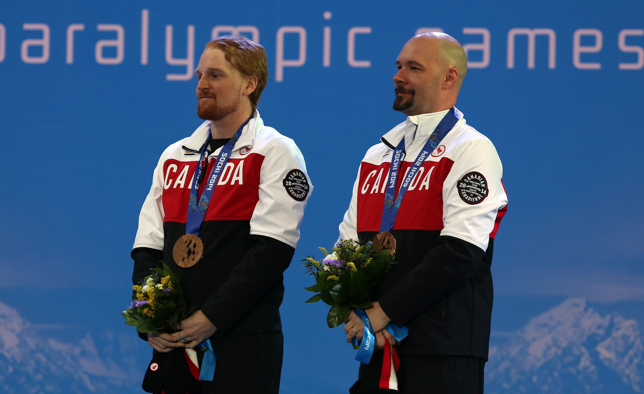 Williamson and Brush celebrate their bonze medal win in the slalom at the 2014 Paralympic Winter Games in Sochi, Russia