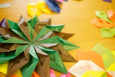 leaf(0.0), wheel(0.0), petal(0.0), art(1.0), art paper(1.0), symmetry(1.0), origami(1.0), flower(1.0), yellow(1.0), paper(1.0), green(1.0), origami paper(1.0), craft(1.0),