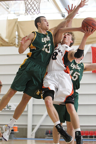 Chas Kok goes hard to basket vs UNBC (vertical Oct 14, 2011 A. Snucins)