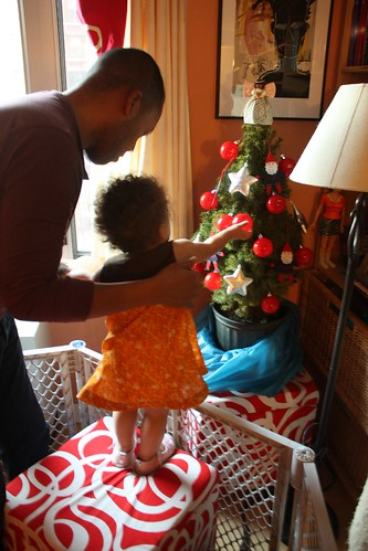 Z decorates the tree in her Tea Party sundress