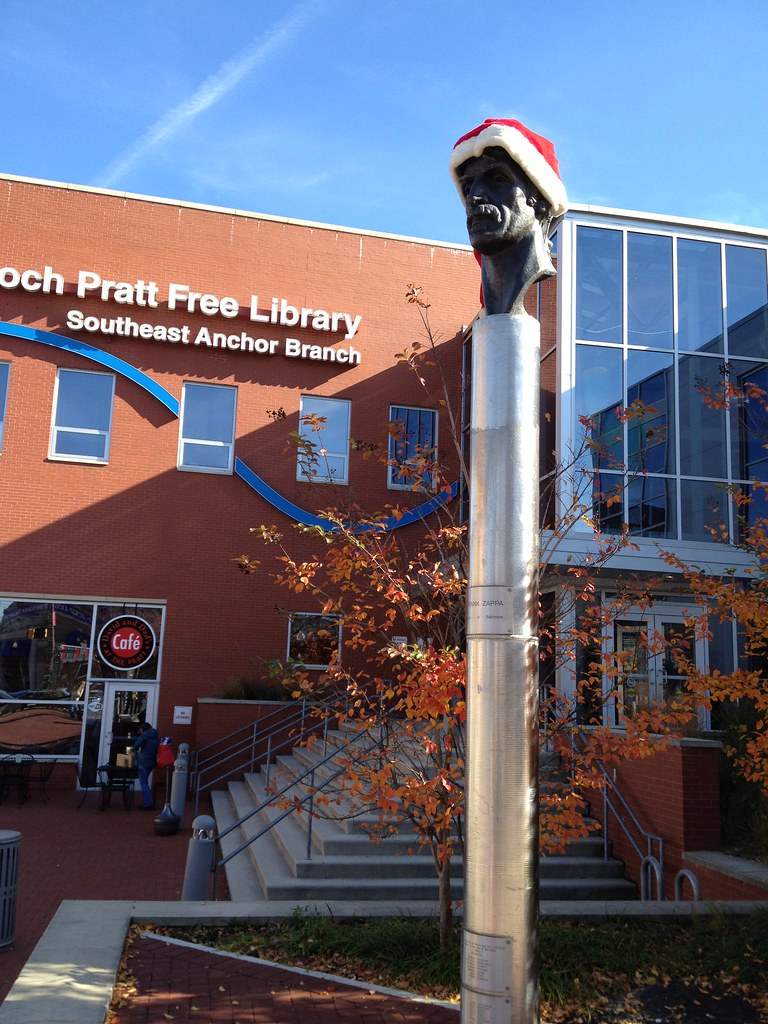 Outside the Southeast Anchor Branch of the Enoch Pratt Library, there is a statue of Frank Zappa with Santa hat on his head for the holidays