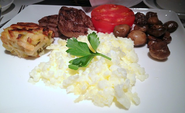 Freshly Scrambled Organic Free Range Egg Whites served with Steak, Sauteed Button Mushrooms, Roast Tomato and Potato Cake